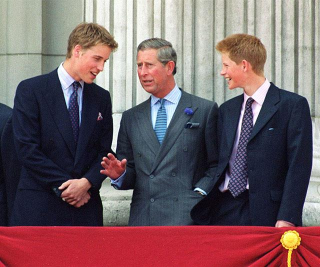 **Duty calls:** The Windsor trio gather on the balcony of Buckingham Palace for The Queen Mother's 100th birthday celebrations in 2000. *(Image: Getty)*