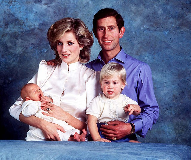**The early years**: Princess Diana cradles a newborn Prince Harry while Prince Charles holds Prince William back in 1984. *(Image: Rex Features)*