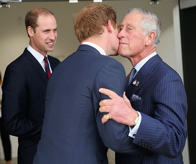 **A kiss for pa:** Prince Harry proves you're never too old to show affection towards your dad. *(Image: Getty)*