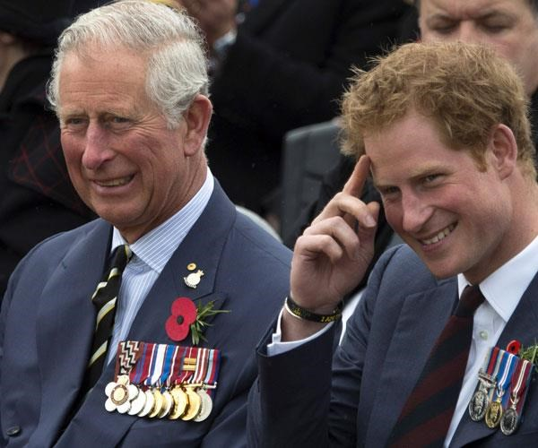 """**Like father, like son:** Harry and his beloved """"pa"""" are both decorated soldiers. *(Image: Getty)*"""