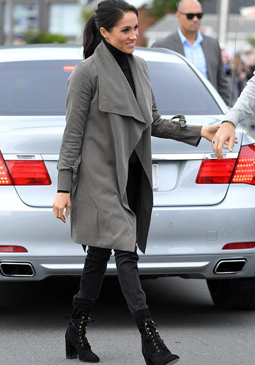 She paired the look with a black turtleneck, skinny jeans and heeled boots by Stuart Weitzman. *(Image: Getty Images)*