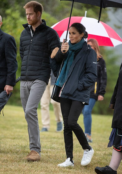 The royals wrapped up for a visit to Abel Tasman National Park, which is located at the top of the South Island of New Zealand. Meghan wore a Seasalt jacket paired with her Jac + Jack roll-neck sweater and a teal scarf. *(Image: Getty Images)*