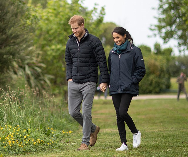 The Duchess ditched the heels to take in the scenic views of the area, wearing Stella McCartney x Adidas sneakers. *(Image: Getty Images)*