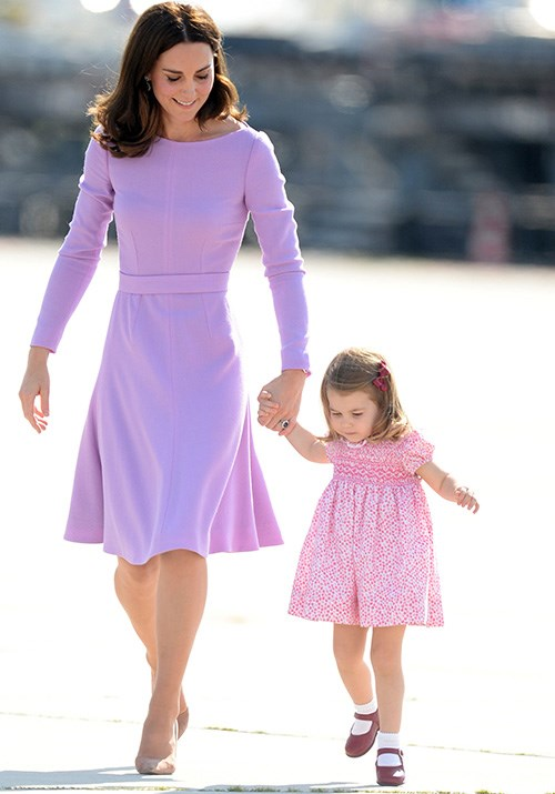 Royal pairing Duchess Catherine and Princess Charlotte look picture perfect in their adorable pastel pink and purple ensembles. *(Image: Getty Images)*