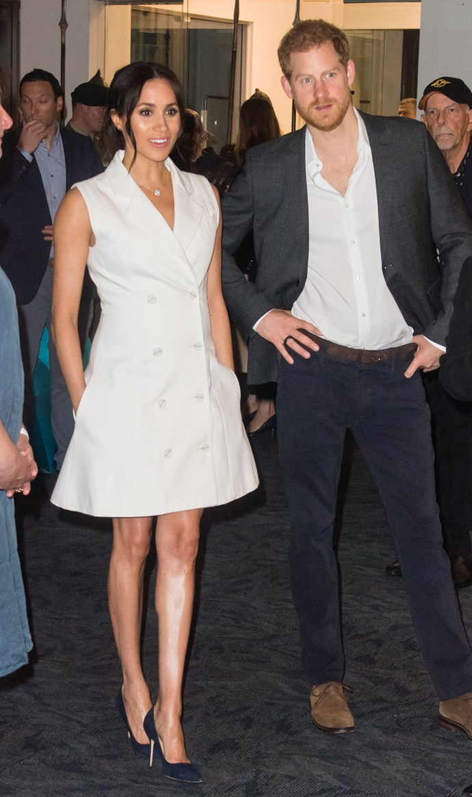 Meghan and Harry visited Courtenay Creative in Wellington, NZ on Monday evening where they celebrated the city's vibrant arts culture with guests. The Duchess looked chic in a Maggie Marilyn tuxedo dress and navy Manolo Blahnik pumps. *(Image: Getty Images)*