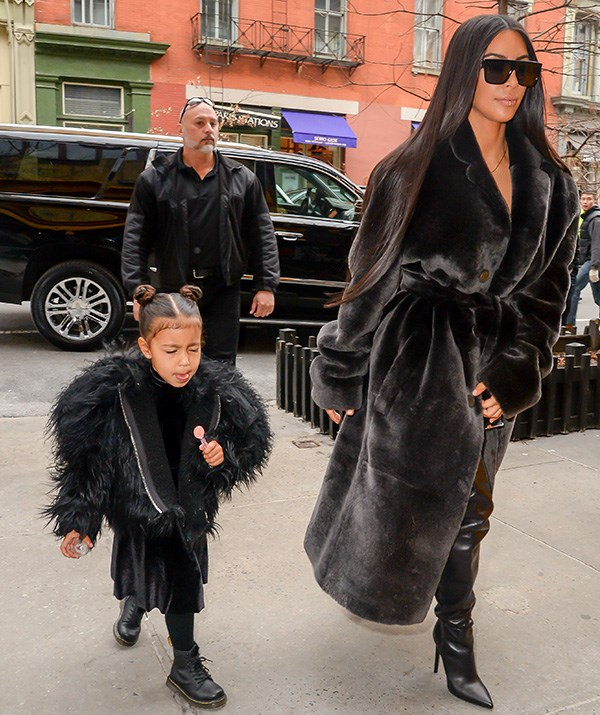 Kim Kardashian and daughter North West don't do things by halves, especially when it comes to their wardrobes. In this case, *black* is the new black for this stylish duo! *(Image: Getty Images)*