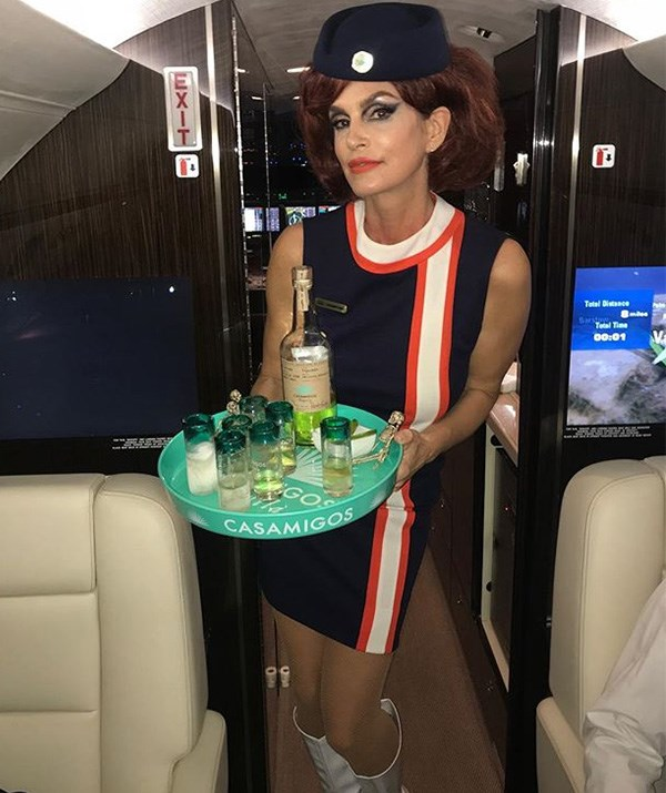 Come fly with... Cindy Crawford? The striking model nailed the outfit and has all the props to boot! *(Image: Instagram / @cindycrawford)*