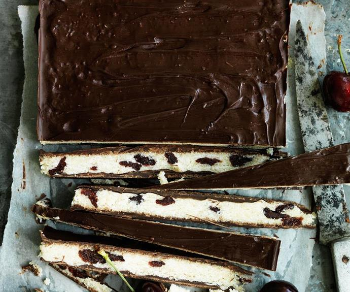 """Choc-cherry coconut bars, recipe at our sister site [Women's Weekly Food](https://www.womensweeklyfood.com.au/recipes/choc-cherry-coconut-bars-29440