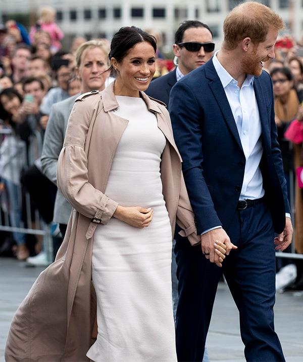 One lucky fan of Meghan Markle's got more than she bargained for when she waited to meet the royals in New Zealand on Tuesday. *(Image: Getty)*