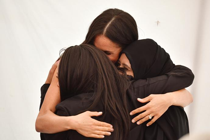 The Sussex baby is going to be one lucky little bub, judging by the warmth of his or her Mum's hug for these ladies at the launch of a cookbook in September with recipes from a group of women affected by the Grenfell Tower fire in London. *(Image: Getty Images)*