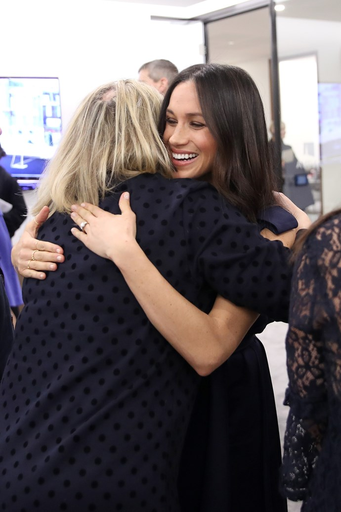 Pictured at the first annual Royal Foundation Forum in February, the Duchess hugs journalist Bryony Gordon. The Foundation was set up in 2009 for the young Royals to be able to tackle some of their biggest passions, in particular in the field of mental health. *(Image: Getty Images)*
