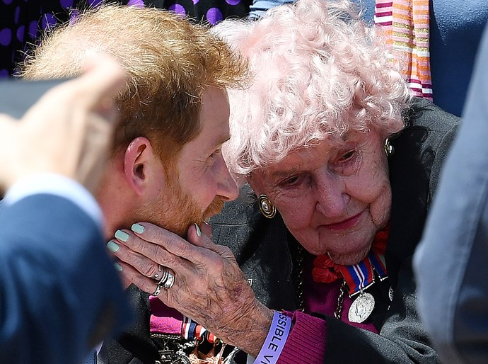 She may be 98 but war widow Daphne Dunne has snagged many a royal hug from her favourite redhead over the years. Here, she shows how the pros do it with a sweet touch of Prince Harry's cheek. There's no denying this is one royal who knows how to wow the crowds. And the best bit? We're 100 percent sure it comes from the heart. *(Image: Getty Images)*