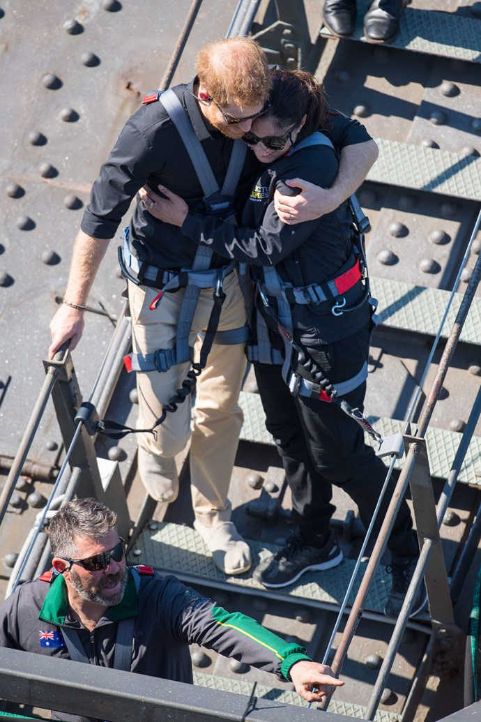 Prince Harry took the time to comfort war veteran's widow Gwen Cherne as they climbed the Harbour Bridge in Sydney together. *(Image: Getty Images)*
