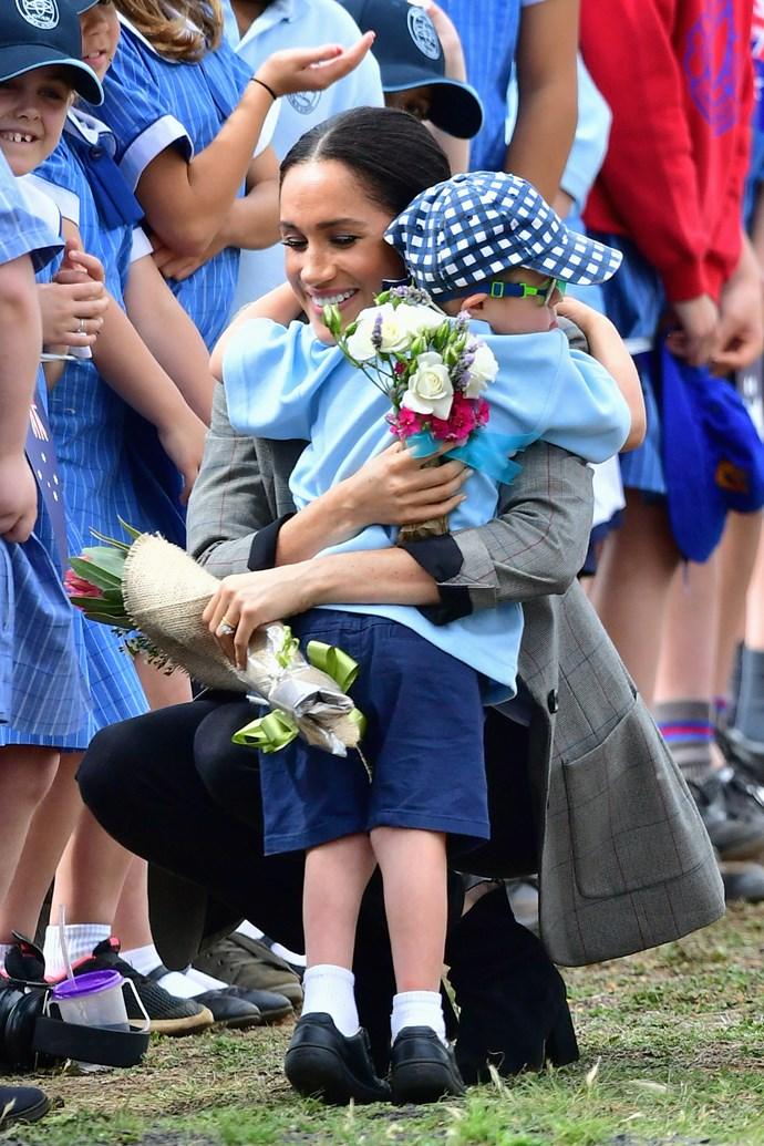 Her Royal Hugness made hearts melt with this adorable hug for little Luke in Dubbo. *(Image: Getty Images)*