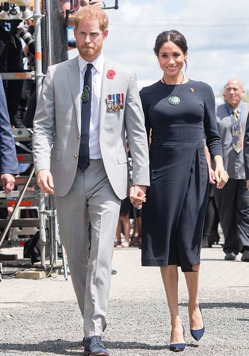 The royal couple also visited Rotorua's Te Papaiouru Marae. Meghan's navy blue Stella McCartney dress looked effortless. *(Image: Getty Images)*