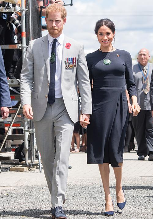 The royal couple also visited Rotorua's Te Papaiouru Marae. Meghan's navy blue Stella McCartney dress looked effortless. *(Image: Getty Images)*