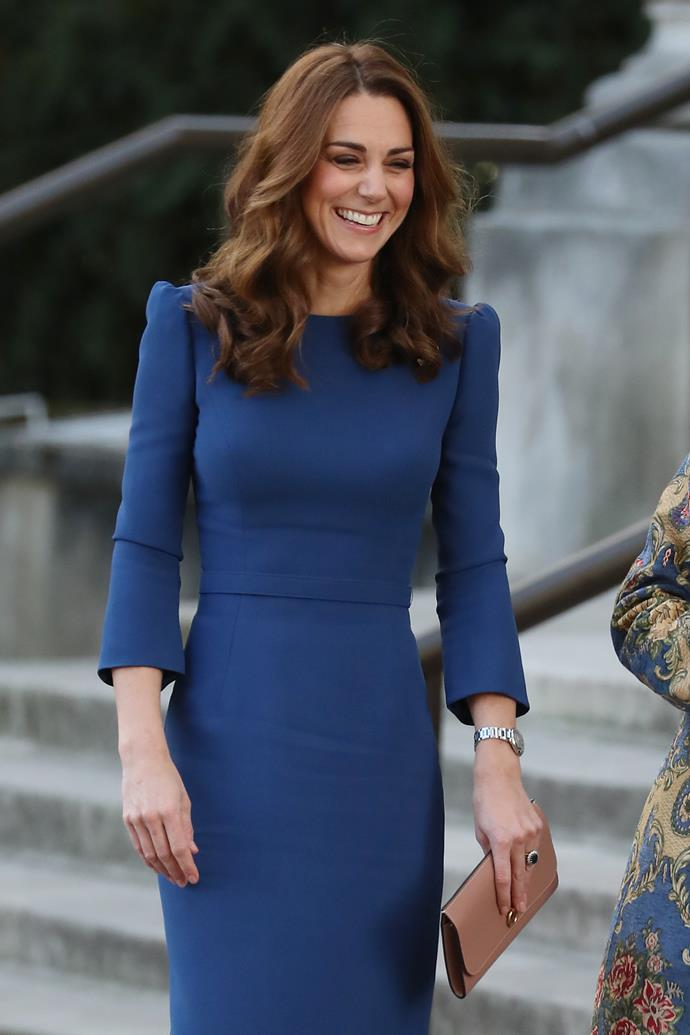 Kate looked stunning in a royal blue Jenny Packham dress, which she wore two years ago in Canada. *(Image: Getty)*