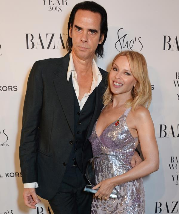 Kylie was presented with her Music Icon award by the *other* Aussie music icon, Nick Cave. *(Image: Getty Images)*