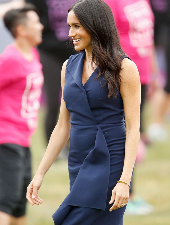 The navy blue Dion Lee dress worn by Meghan in Melbourne caused the designer's site to crash as fans flocked to view it online. *(Image: Getty)*