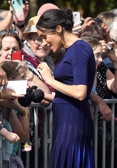 Adoring fans were not deterred from the Duchess despite the mishap. *(Image: Getty)*