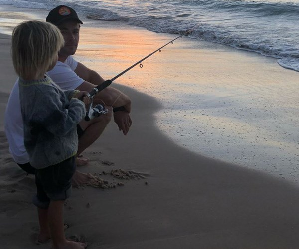 Father/son fishing in their hometown of Byron Bay *(Image: Instagram @chrishemsworth)*