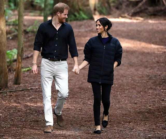 Meghan and Harry embraced New Zealand nature by visiting Redwoods Treewalk in Rotorua on Wednesday. In a cute gesture, the Duchess donned Harry's Oslo down jacket - it must have been chilly! *(Image: Getty Images)*