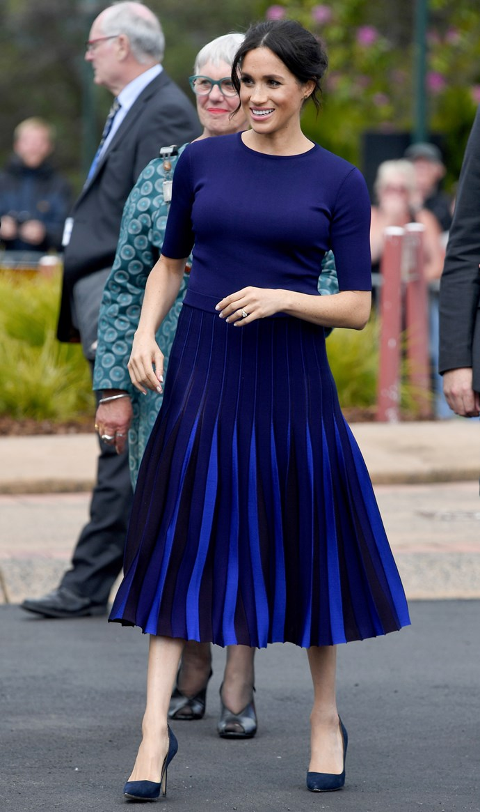 Stepping out to meet fans in Rotorua, the Duchess turned heads in this Givenchy top and skirt ensemble. *(Image: Getty Images)*