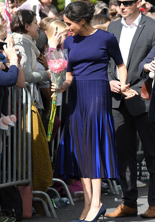 "But the eye-catching look turned heads for more than one reason - the pleated skirt [turned transparent in the sun](https://www.nowtolove.com.au/royals/british-royal-family/meghan-markle-see-through-skirt-52162|target=""_blank""), revealing a little more of the Duchess than we expected! *(Image: Getty Images)*"
