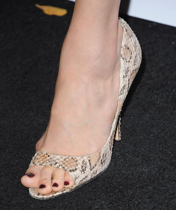 Duchess Meghan's left foot pre-bunion surgery when she – gasp! – dared to set foot at the GQ Awards in 2013 with the offending bone on display. *(Image: Getty Images)*