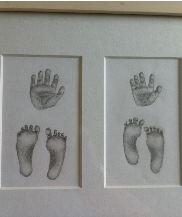 The hand and footprints of my premature twin daughters who did not survive. *(Image: Supplied)*