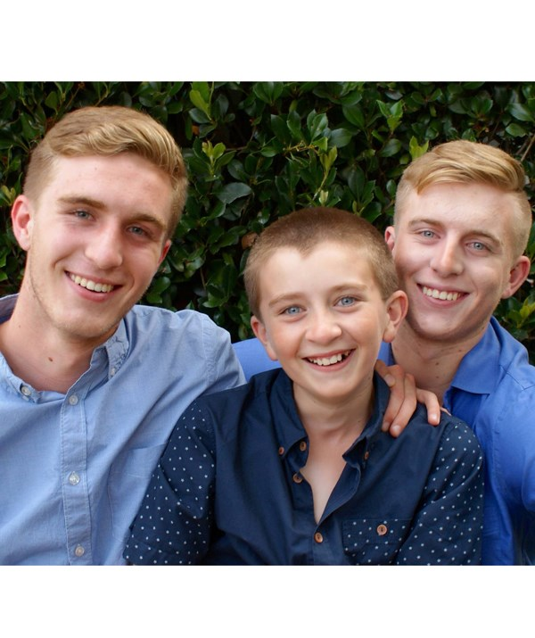 Miracles *do* happen. My premature eldest boys, Louis, 17, (left) and Joss, 19, (right) with their brother Barney, 12, (middle) who went full-term. *(Image: Supplied)*