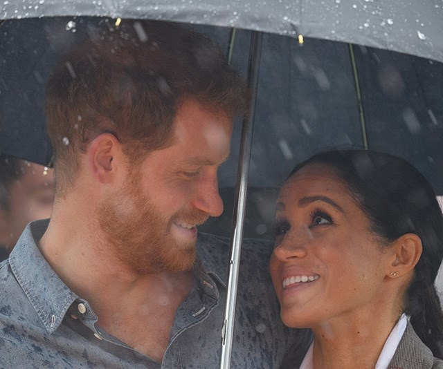 Harry and Meghan couldn't have looked more loved up during their royal tour Down Under. *(Image: Getty)*