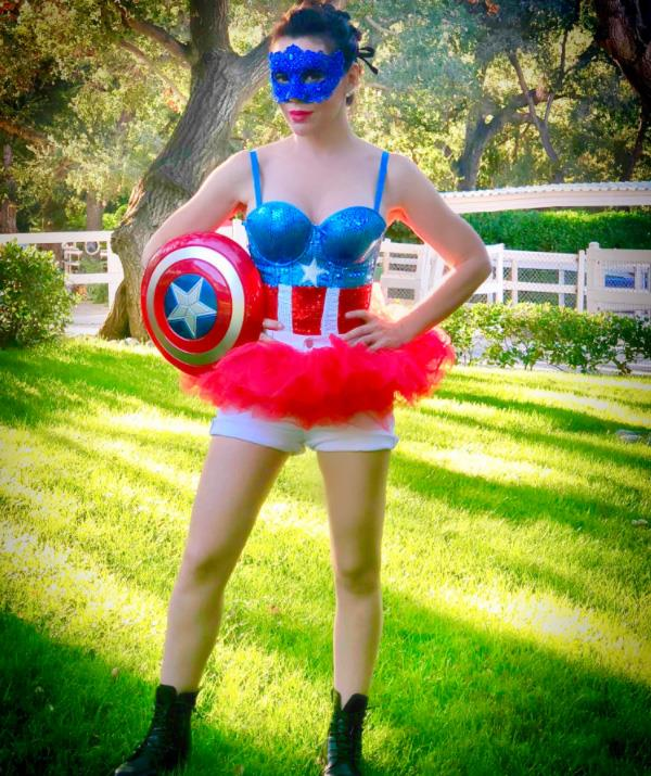 Girl power! Alyssa Milano looked ready to conquer the world as Captain America. *(Image: Twitter: @alyssa_milano)*