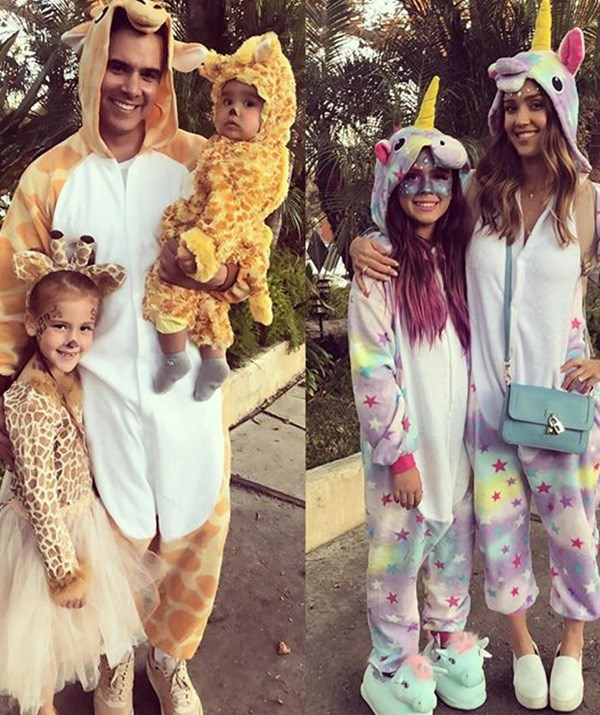 Jessica Alba and her family embraced onsies in full force, dressing as (rather fleecy) giraffes and unicorns. *(Image: Instagram: @jessicaalba)*