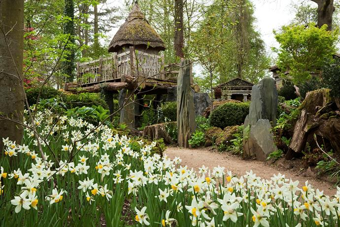 The treehouse that Prince Charles built for his children. *(Image: GAP Photos/Highgrove - A Lawson - The Stumpery Design)*