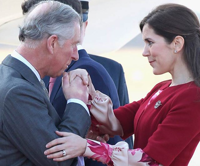 Prince Charles greets Crown Princess Mary in 2012 *(Image: Getty Images)*
