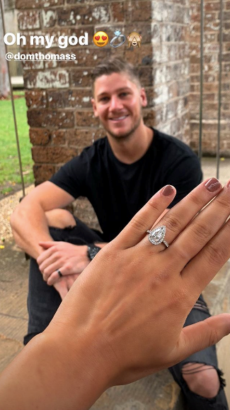 Is this for real? It looks like Tayla Damir and Dom Thomas are ENGAGED! *(Source: Instagram)*.