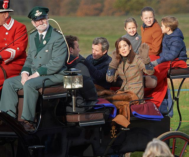 A royal wave! Crown Princess Mary, Crown Prince Frederick were joined by Princess Isabella and twins Princess Josephine and Prince Vincent for the Hubertus Hunt in Copenhagen, Denmark over the weekend. *(Image: hbgbild/MEGA)*