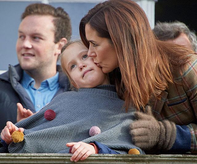 Mummy's little girl: Princess Mary plants a loving kiss on Princess Josephine's cheek. *(Image: hbgbild/MEGA)*