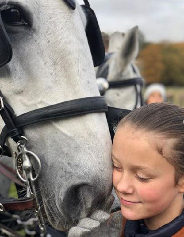 Princess Isabella shares a sweet moment with one of the horses. *(Image: @detdanskekongehus Instagram)*