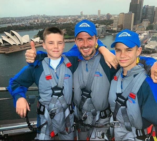 David took Cruz and Romeo to the skies as they climbed the Sydney Harbour Bridge during the Invictus Games. *(*(Source: Instagram @davidbeckham)*
