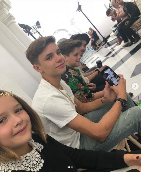 David took this sweet photo of Harper, Romeo, Cruz and Brooklyn front and centre at their mum's fashion show! *(*(Source: Instagram @davidbeckham)*