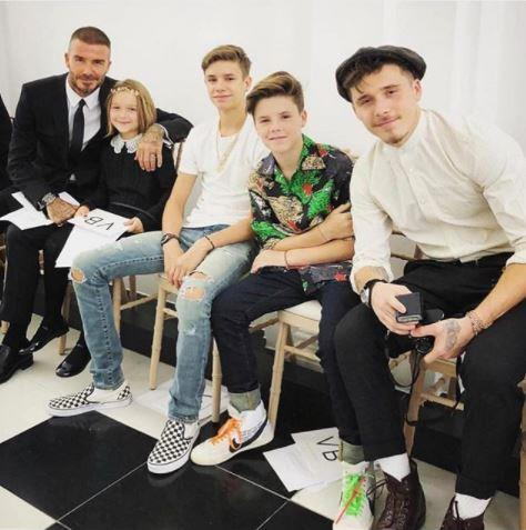 And here's David with the kids, waiting for Victoria's fashion show to begin! *(Source: Instagram)*