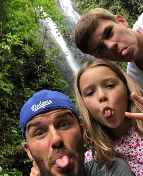 We can see the resemblance in these tongues... David, Harper and Romeo pull funny faces while on holidays. *(Source: Instagram)*