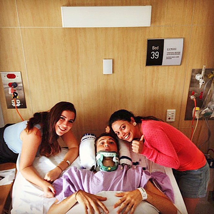Ry's sisters cheer him up in hosptial.