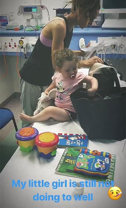Michael shared this glimpse of his daughter in the emergency room *(Image: Michael Clarke Instagram)*