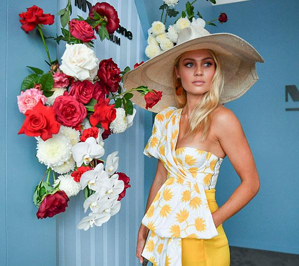 "[*The Block*'s](https://www.nowtolove.com.au/reality-tv/the-block|target=""_blank"") Elyse Knowles is bringing some much needed sunshine to the rainy Melbourne Cup in this sunshine-yellow top and trouser combo.  *(Image: Media Mode)*"