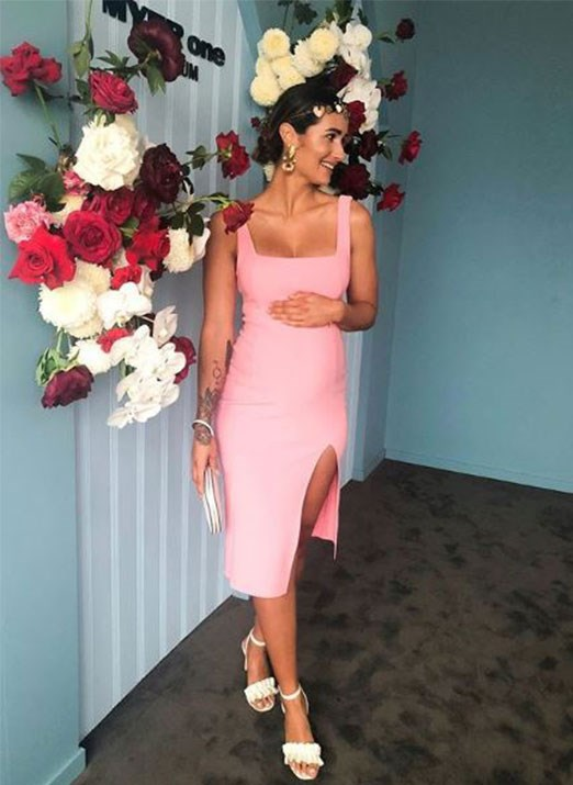 Sarah Boulazeris cradles her baby bump, could pink be a hint? *(Image: Media Mode)*