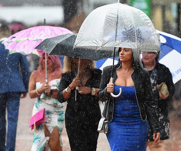 The rain is coming down hard and fast in Flemington. *(Image: Getty Images)*
