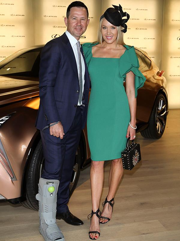 Cricket legend Ricky Ponting sported some interesting footwear while wife Rianna Jennifer Cantor, glowed in green beside him. *(Image: Media Mode)*